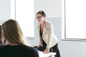 woman-leads-team-meeting