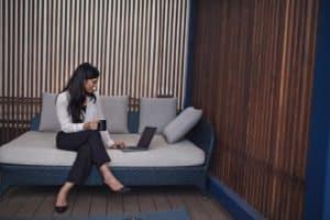 woman-working-on-laptop-on-patio- growbangladesh